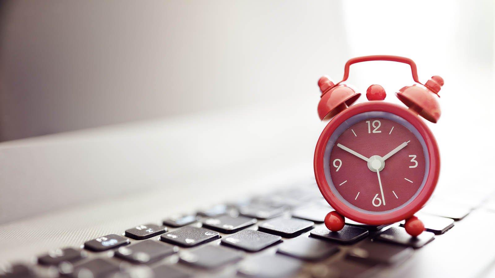 Alarm clock is on a keyboard
